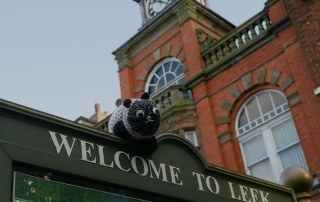 Photo of little lost saul the sheep on welcome to leek sign